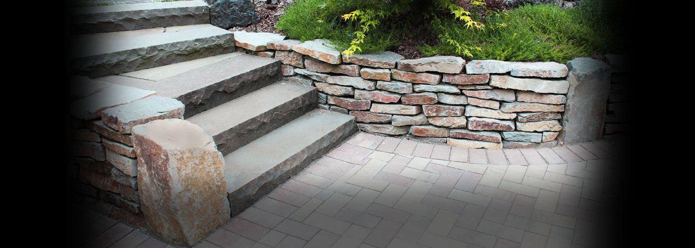 Natural Stone Features Nothing says style and sophistication better than a rustic natural stone landscape feature.
